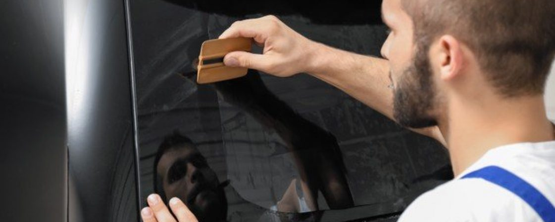 worker-tinting-car-window-shop_392895-16493